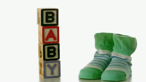 green slippers falling besides baby blocks - capital letter stock videos & royalty-free footage
