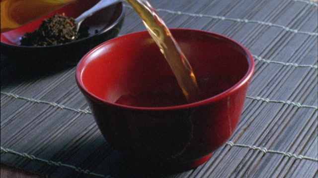 cu, green tea being poured into traditional japanese cup - tea hot drink stock videos & royalty-free footage