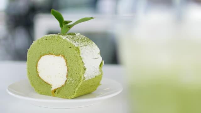 Green tea cake on white table background