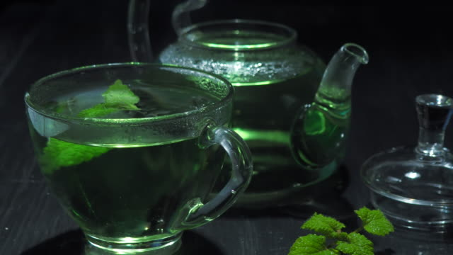 green tea over black - mint leaf culinary stock videos and b-roll footage