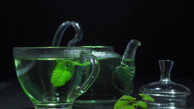 green tea over black - tea cup stock videos & royalty-free footage