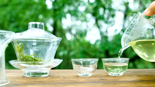 green tea pouring into cup - teapot stock videos & royalty-free footage