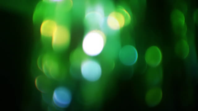 green tinsel blinking backgroubd - tinsel stock videos & royalty-free footage