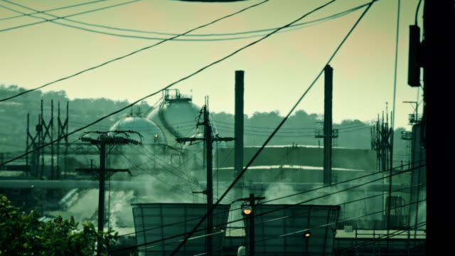 green toned oil refinery shimmer - port of los angeles stock videos & royalty-free footage
