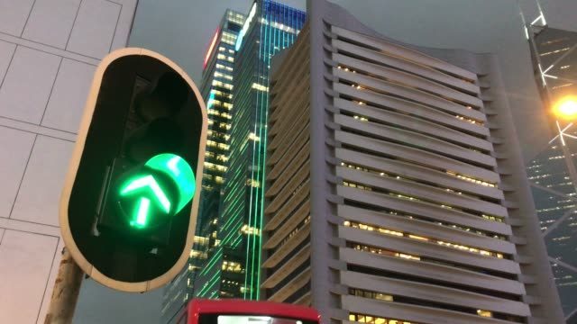 green traffic light turn into red, hong kong city - red light stock videos & royalty-free footage
