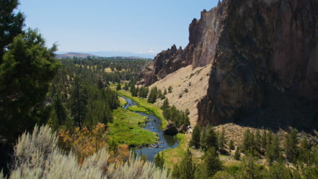 green valley & river through rocky desert landscape - smith rock state park stock videos & royalty-free footage