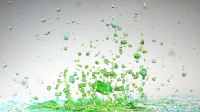 green water dancing color with white background in slow motion - volume fluid capacity stock videos & royalty-free footage