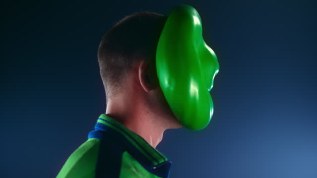 slo mo ld green water filled balloon hitting a man in the face without popping - one mid adult man only stock videos & royalty-free footage
