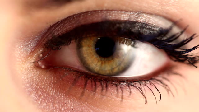 green woman eye extreme close up - closing stock videos & royalty-free footage