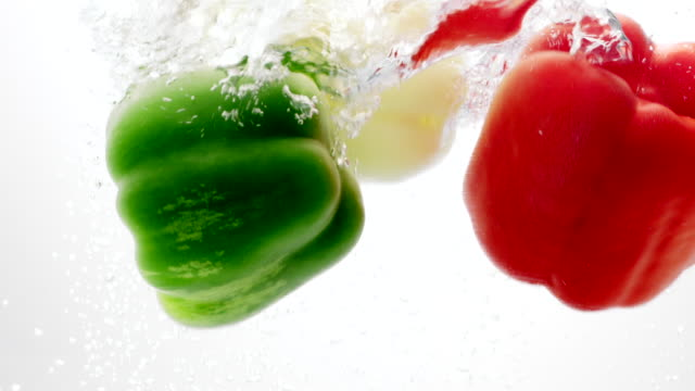 green, yellow and red pepper falling into water - green bell pepper stock videos & royalty-free footage