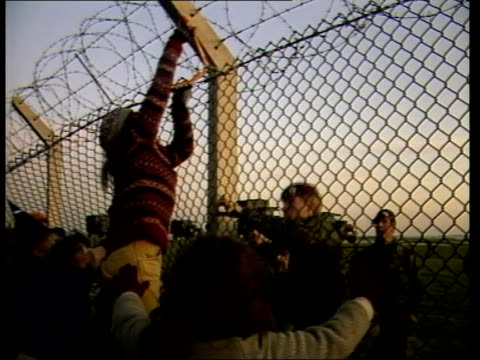 berks greenham common ls women protestors advance on fence ms women one dressed as witch pull at fence as troops look on cms one using wire cutters... - pulling stock videos & royalty-free footage