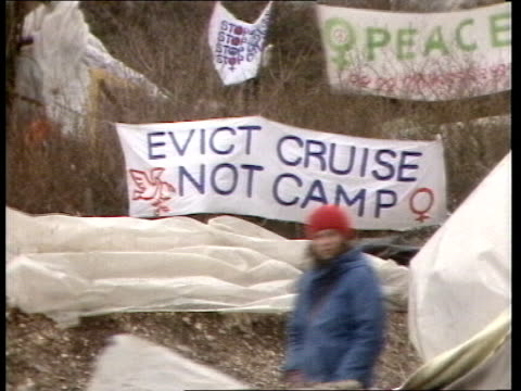 eviction ordered england berkshire greenham common ext / snowing ms police at gates pull out as peacewomen dance in front of them ga police... - dancing back to back stock videos & royalty-free footage