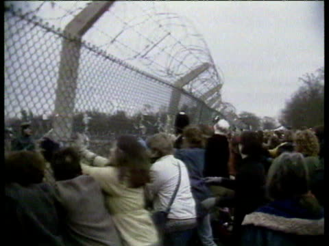 greenham common women's peace group protesting the arrival of nuclear cruise missiles band playing demonstrators pushing fence back and forth almost... - 1983 stock videos & royalty-free footage