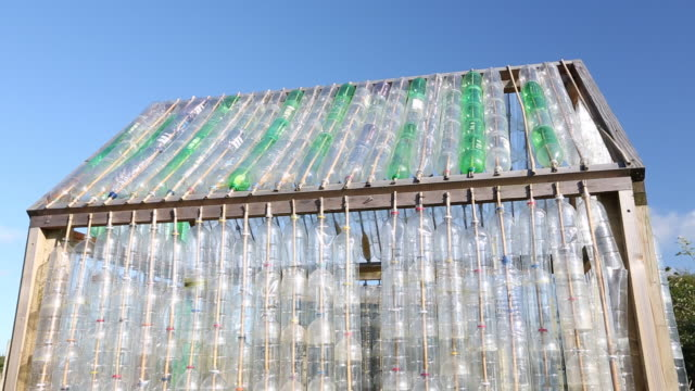 vídeos y material grabado en eventos de stock de a greenhouse made from waste plastic drinks bottle - reutilizable