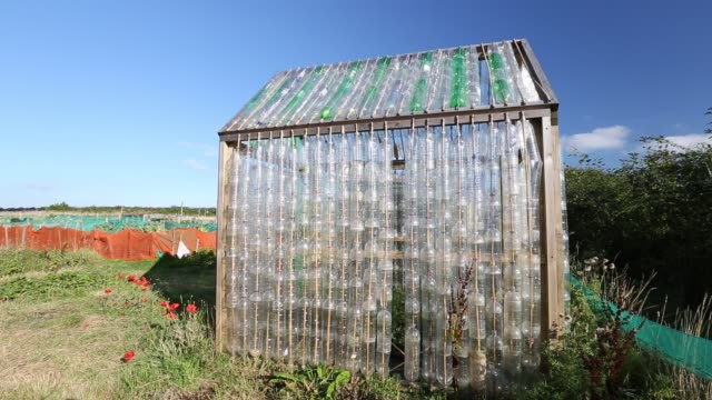 a greenhouse made from waste plastic drinks bottles in the community garden at mount pleasant ecological park porthtowan cornwall uk - organic stock videos & royalty-free footage