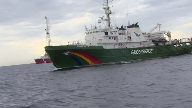 greenpeace activist vessel shadowed by boat from marine management organisation to try and stop them throwing boulders into english channel to... - recreational pursuit stock videos & royalty-free footage