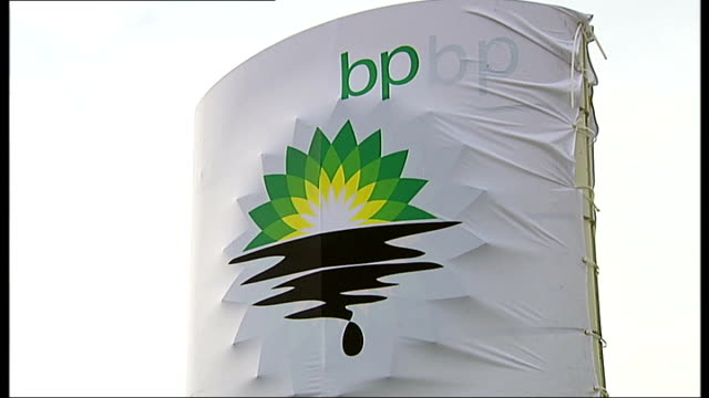 stockvideo's en b-roll-footage met greenpeace activists close london petrol stations in protest against bp oil spill vox pop with angry car driver various views of bp garage with new... - bp