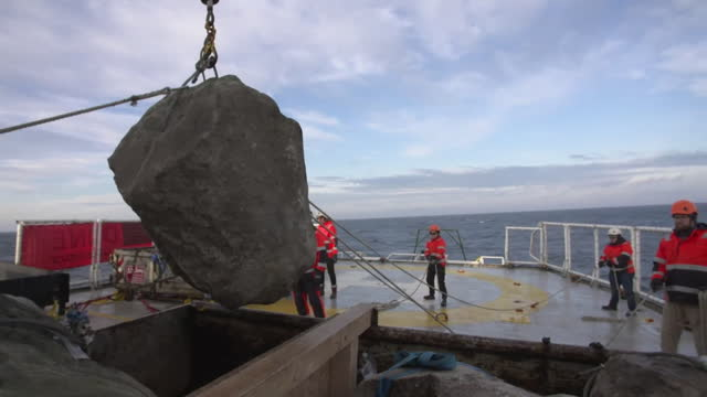 greenpeace activists dropping boulders into the english channel in a bid to stop the destructive method of fishing known as bottom trawling - moving down stock videos & royalty-free footage