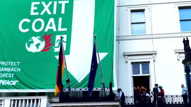 greenpeace activists hang from ropes after unfurling a banner outside the german embassy in a protest against coal on october 8 2018 in london... - fossil fuel stock videos & royalty-free footage