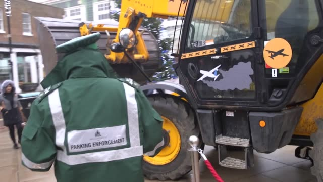 greenpeace activists park a bulldozer on uxbridge high street to campaign against the construction of a third heathrow runway the vehicle plays audio... - construction vehicle stock videos & royalty-free footage