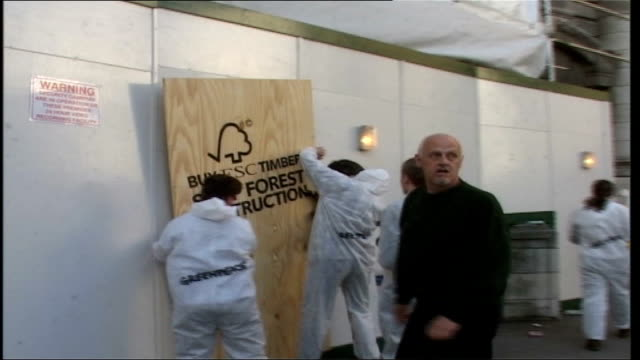greenpeace activists protest at admiralty arch; england: london: trafalgar square: greenpeace activists placing non-endangered plywood panel reading... - stencil stock videos & royalty-free footage