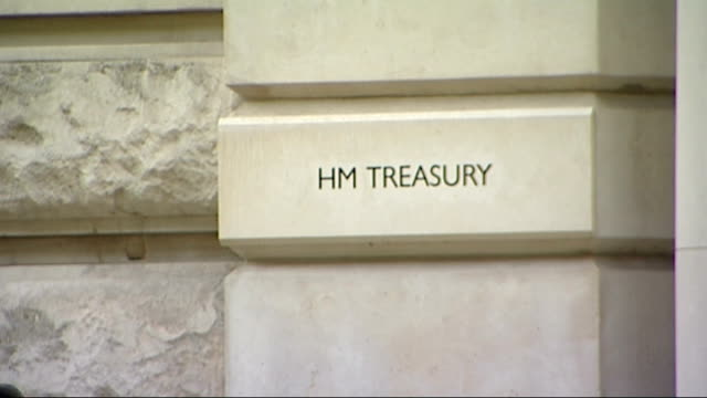 greenpeace activists scale treasury building; england: london: hm treasury: ext greenpeace protesters suspended from treasury building with yellow... - greenpeace stock videos & royalty-free footage