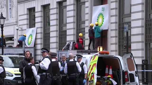 stockvideo's en b-roll-footage met greenpeace bp head office protest england london westminster st james st james square bp headquarters ext st james' square sign / police at scene of... - bp