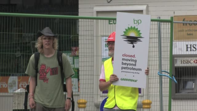 greenpeace protest at bp filling station - greenpeace stock videos & royalty-free footage