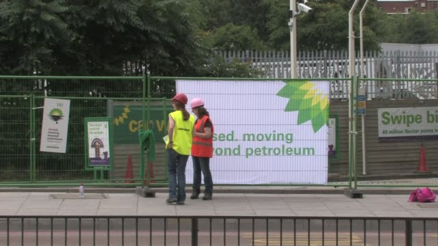 greenpeace protest at bp filling station - station stock videos & royalty-free footage