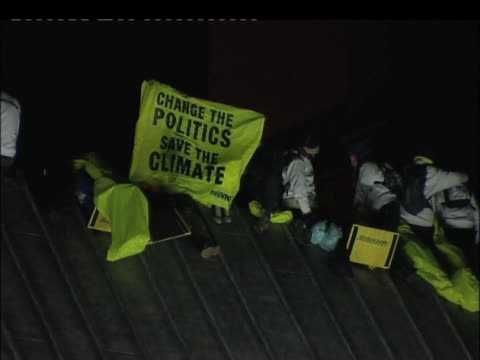 greenpeace protestors on roof of houses of parliament at night london; 12 october 2009 - 2000s style stock videos & royalty-free footage