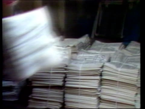 greenpeace rainbow warrior sinking:; france: paris: tcms le monde newspaper on the press piles of newspapers placed in van for distribution pull out... - greenpeace stock videos & royalty-free footage