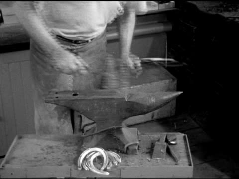 greentree stable blacksmith gilbert stelling making thoroughbred racehorse horseshoes heating shaping trainer john gaver sr walking in sot asking if... - horseshoe stock videos and b-roll footage
