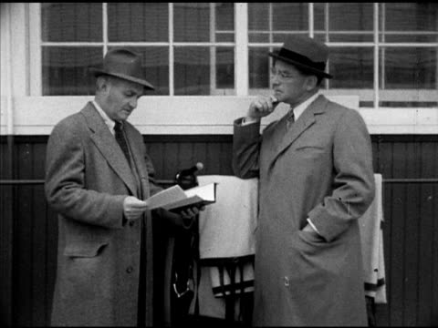 greentree stable thoroughbred racehorse trainer john gaver sr w/ owner john 'jock' hay whitney sot 'jock' asking how palm tree did john saying shins... - john hay whitney stock videos and b-roll footage