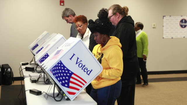 greenville, south carolina, usa: voters cast ballots at the west end community development center during the 2020 south carolina primary, saturday,... - ballot slip stock videos & royalty-free footage
