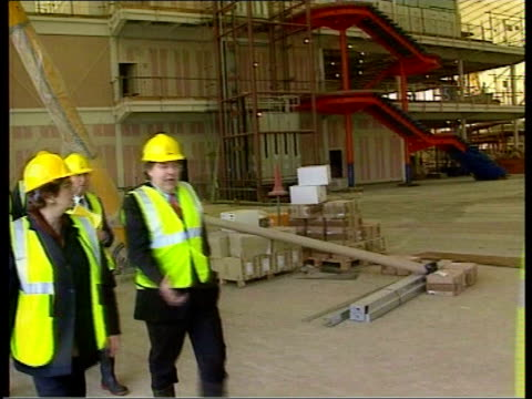 millennium dome falconer along at dome site wearing hard hat gv roof of half finished dome pan falconer along with others lib blair standing drinking... - adagiarsi video stock e b–roll