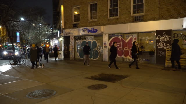 greenwich village nyc, pedestrians, graffiti covered store front - scott mcpartland stock videos & royalty-free footage