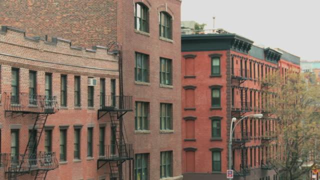 ms greenwich village residential brick buildings / new york, new york, usa - establishing shot stock videos & royalty-free footage