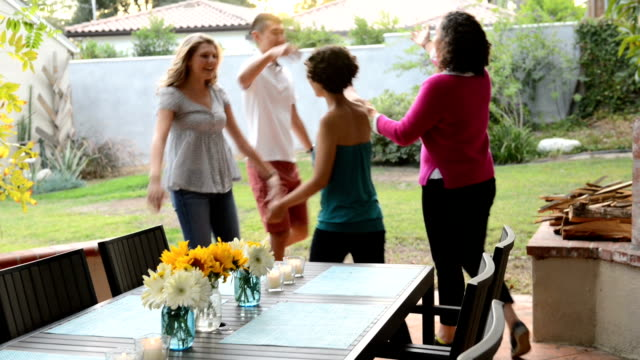 greeting friends at summer bbq - barbecue stock videos & royalty-free footage
