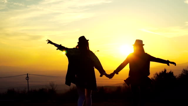 greeting the autumn sun - holding hands stock videos & royalty-free footage