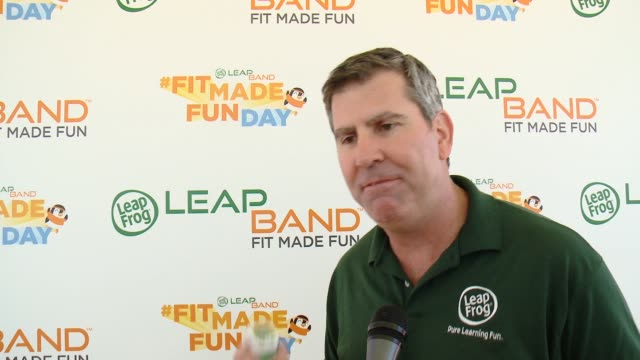interview greg ahearn on fit made fun day on the importance of kids getting up and active on the leap band on the importance of having mia hamm at... - leapfrog stock videos & royalty-free footage