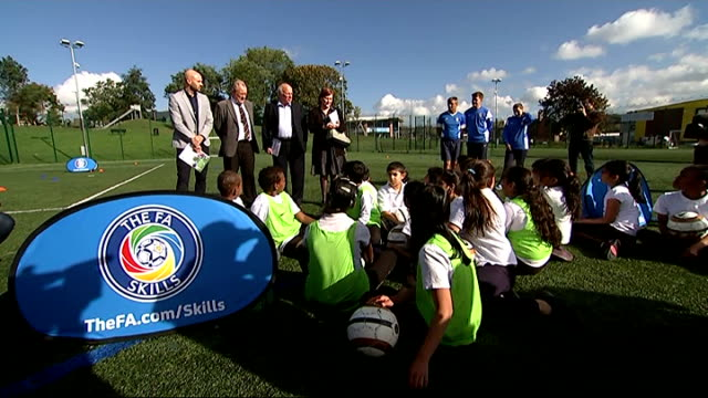 greg dyke says grassroots game is at 'crisis point' south yorkshire sheffield ext greg dyke talking to group of schoolchildren at opening of 'fa... - greg dyke stock videos and b-roll footage