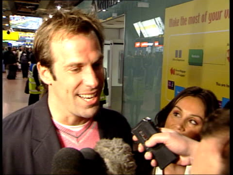 Greg Rusedski arrives home after drug hearing ITN London Heathrow Airport British tennis player Greg Rusedski towards thru airport with wife Lucy as...