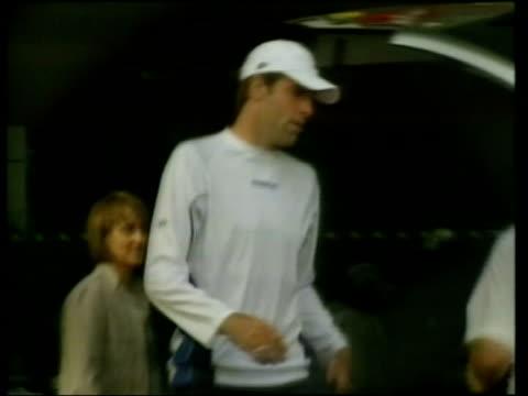 Greg Rusedski fails drugs test LIB London Wimbledon Rusedski out of club and into car