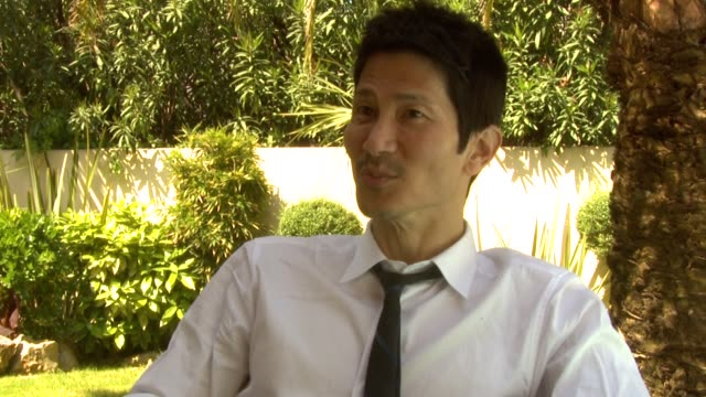 gregg araki on making a cult movie on putting in scenes you don't normally see at the kaboom interviews cannes film festival 2010 at cannes - cult stock videos & royalty-free footage