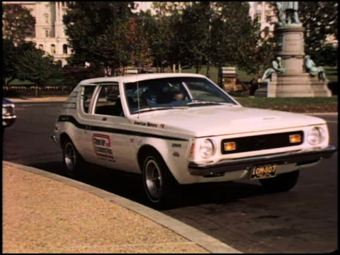 of 1973 amc gremlin parked at the curb of a traffic circle across from the united states capitol building; garfield monument is in the background amc... - 1973 stock videos & royalty-free footage