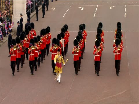 Grenadier Guards band marching in front of crowds on the day of the Royal Wedding of Prince William and Catherine Middleton