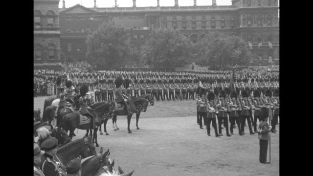 grenadier guards marching band / king edward viii on horseback wearing grenadier guard uniform with black arm band salutes / band marches on parade... - queen's birthday stock videos & royalty-free footage