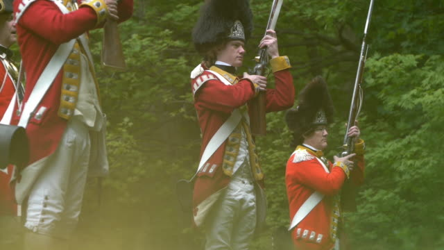 grenadier soldiers firing muskets and then reloading - revolution stock videos & royalty-free footage