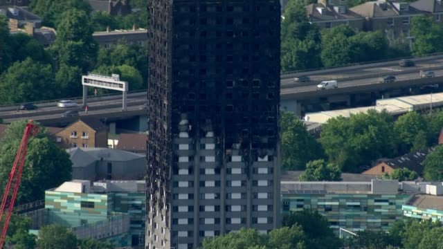 Jeremy Corbyn calls for money to be set aside for installation of sprinkler systems DATE Blackened remains of Grenfell Tower