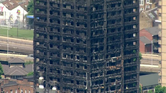 111 more buildings have unsafe combination of cladding and insulation june 2017 north kensington burntout blackened shell of grenfell tower - isoliermaterial stock-videos und b-roll-filmmaterial